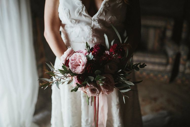 Bride in Jenny Yoo wedding dress with pink bouquet