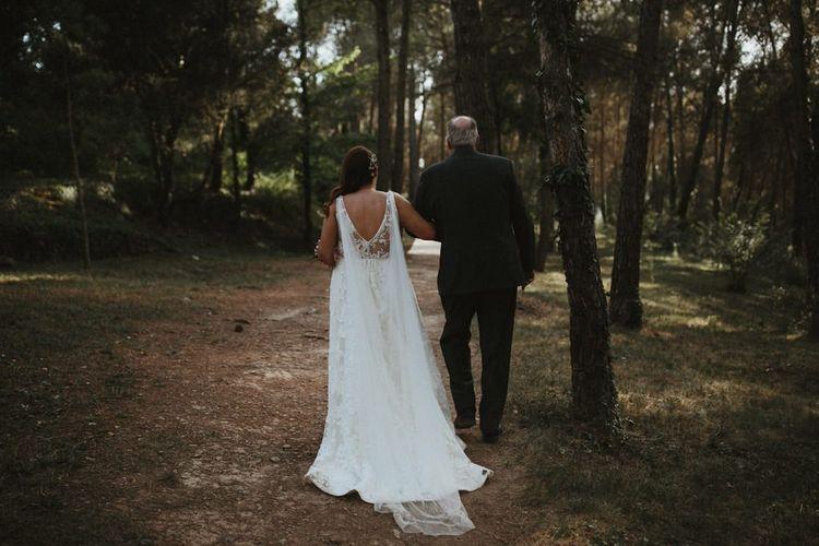 Bride in Jenny Yoo wedding dress with Watteau train