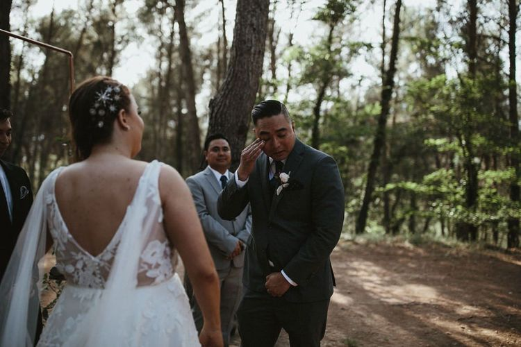 Grooms reaction to seeing bride in Jenny Yoo wedding dress with Watteau train