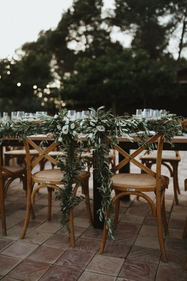 Wedding breakfast table decor with foliage table runner