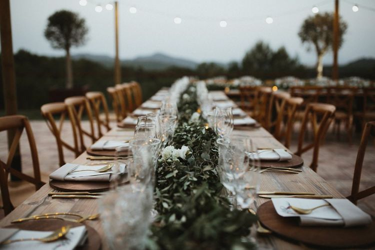 Foliage table runner on banquet wedding tables