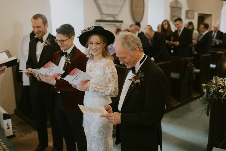 Bride, Groom and Father at the Altar During the Wedding Ceremony