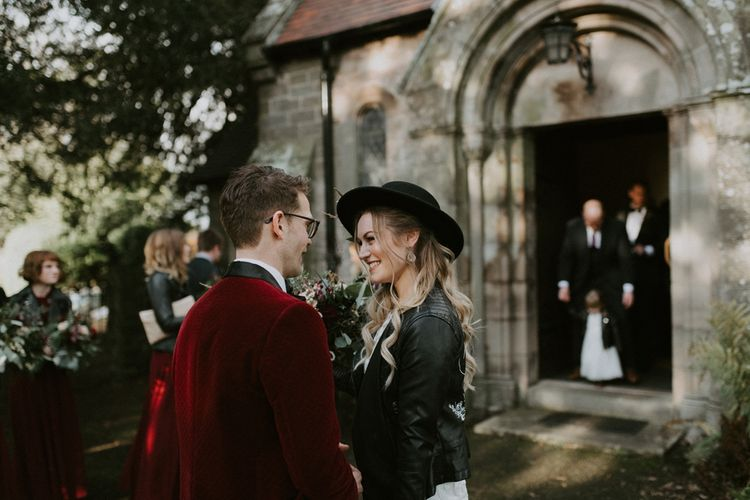 Bride and Groom Smiling at Each Other Outside the Church