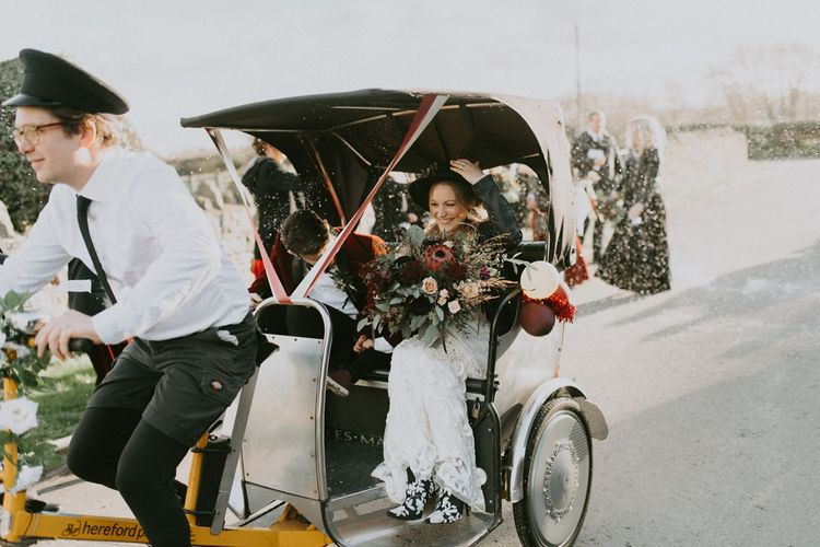 Bride and Groom in a Tuc Tuc with White Confetti Thrown Over Them