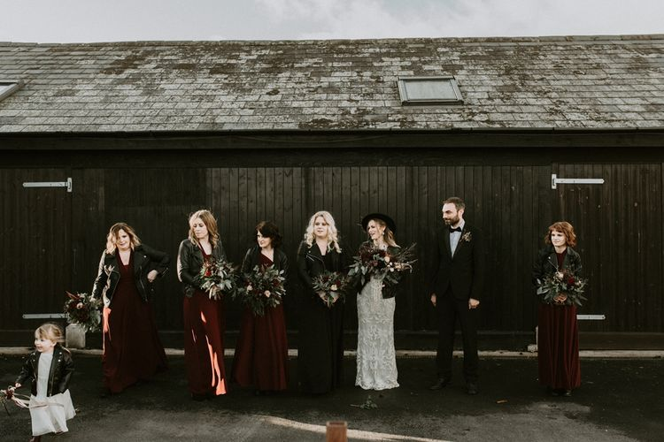 Wedding Party Portrait with Bridesmaids in Deep Red Dresses and Leather Jackets