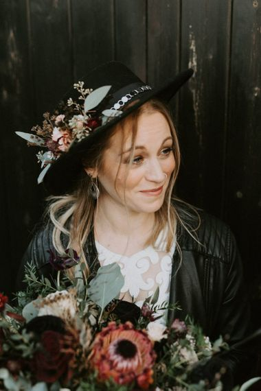 Stylish Bride in Black Fedora Hat with Leather Jacket