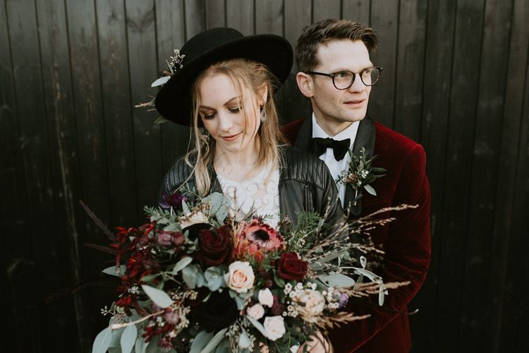 Stylish Bride and Groom in Fedora Hat, Leather Jacket, Velvet Blazer and Bow Tie