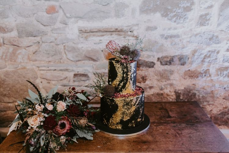Black Two Tier Wedding Cake with Gold Details