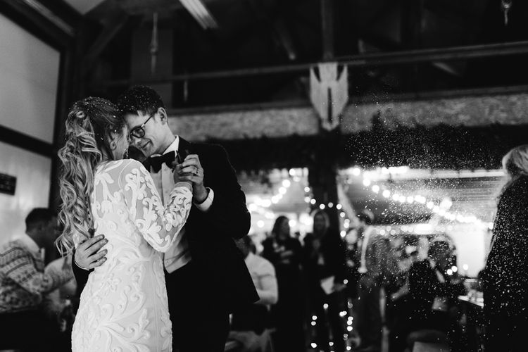 First Dance with Bride in Phase Eight Wedding Dress and Groom in Tuxedo Under a Snow Machine