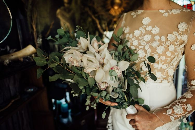 Bridal bouquet with white flowers at woodland wedding