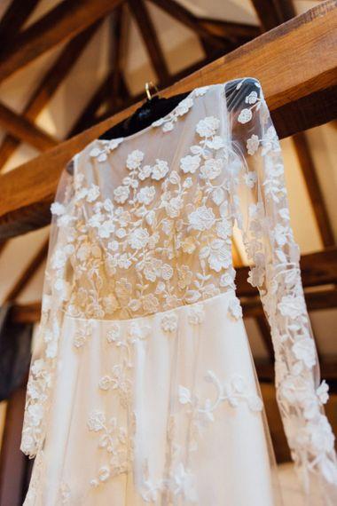 Appliqué bridal wedding jumpsuit at same sex woodland wedding celebration in autumn