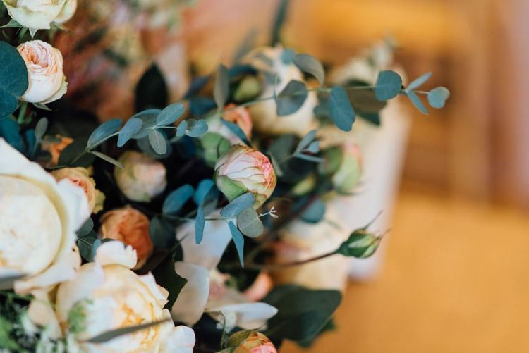 Floral decor at relaxed, outdoor woodland wedding celebration