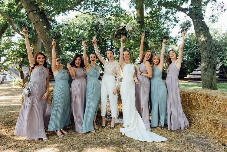 Autumn woodland celebration with bridesmaids in pastel halter neck dresses