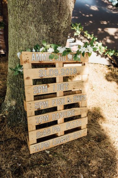 Wooden palettes order of the day at secluded woodland celebration in autumn