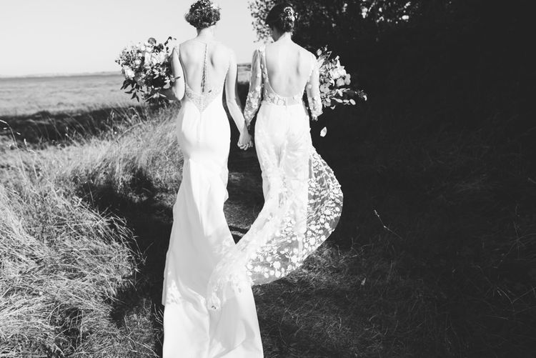 Two brides at relaxed woodland celebration in autumn