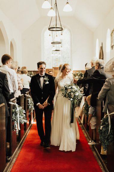 Newlywed husband and wife at Askham Hall wedding