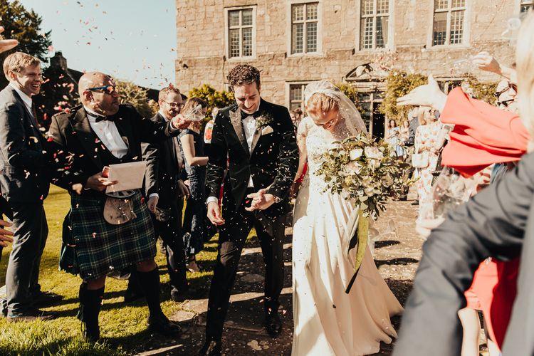 Bride and Groom confetti exit at Askham Hall wedding
