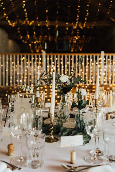 Beautiful wedding decor at Askham Hall wedding  with fairy light canopy candles and foliage