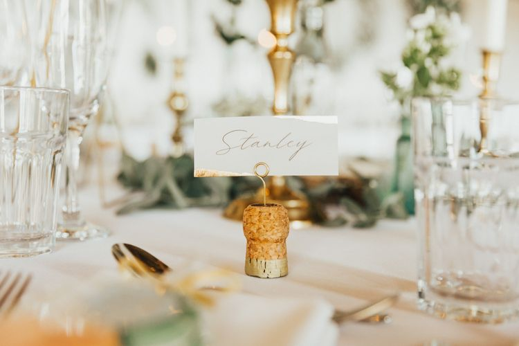 Gold wedding table decoration and place name holders
