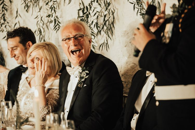 Wedding guests enjoy the wedding speeches at Askham Hall wedding