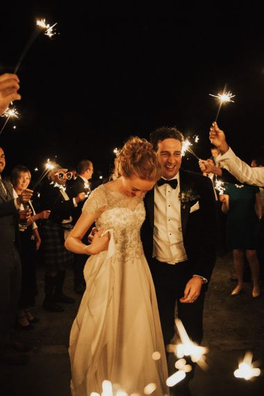 Sparkler exit for bride and groom at Askham Hall wedding