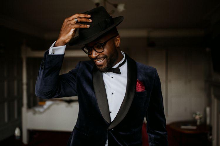 Stylish groom in Fedora hat