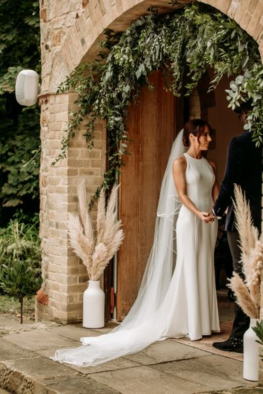 Beautiful bride in minimalist Wendy Makin wedding dress