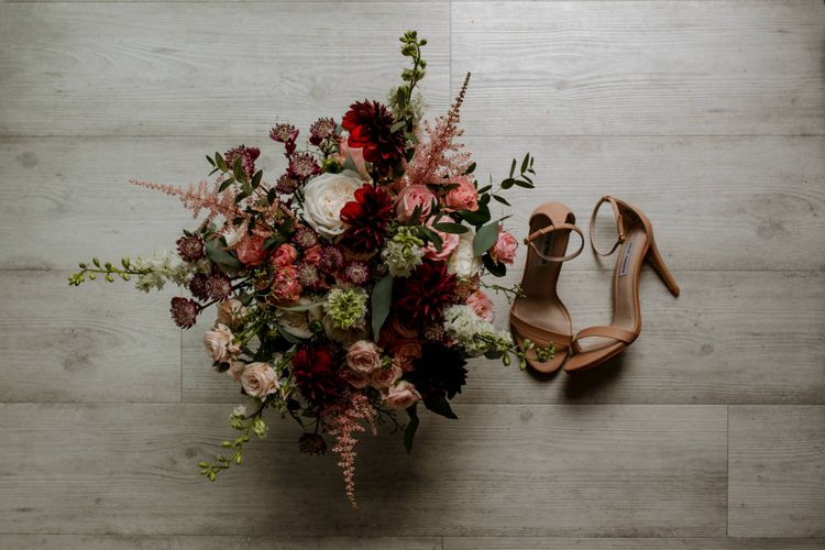 Pink and red flower wedding bouquet and bridal shoes