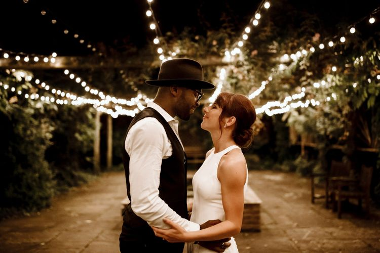 Bride and groom portrait at The Ravenswood with festoon lighting