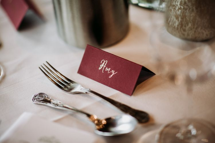 Burgundy name place card with gold font