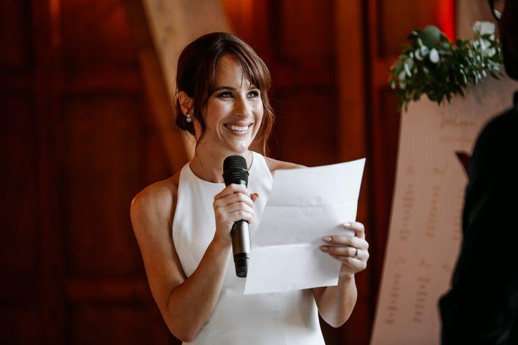 Bride in halter neck wedding dress giving at speech