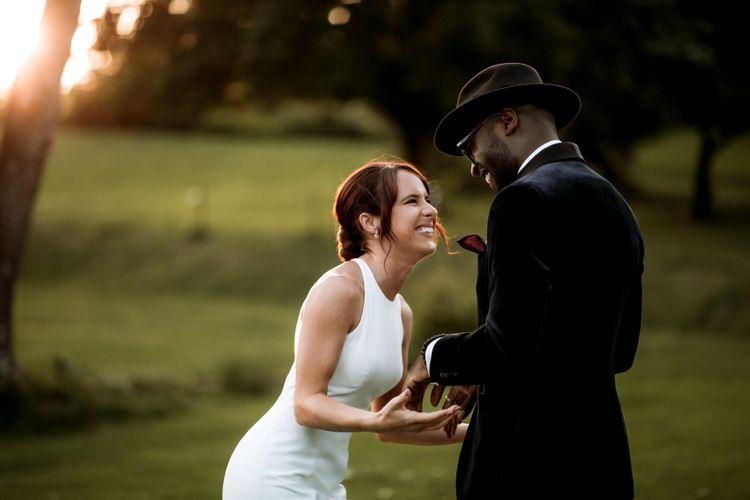 Happy bride and groom portraits by Paul & Nanda