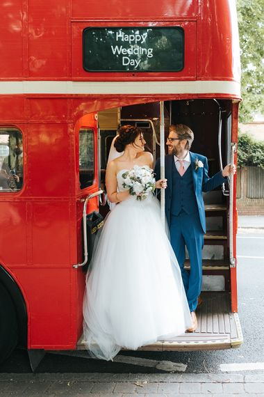 Red London Bus Wedding Transport // The Groucho Club Private Members Club London Wedding With Bride In Sequinned Dress & Flowers By Daisy Ellen Images By Miss Gen Photography