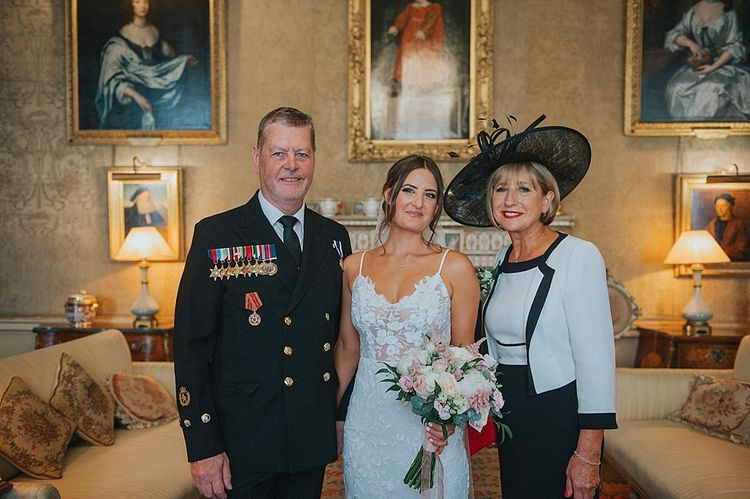 Bride with Parents Before Ceremony Holding Pink and White Bouquet