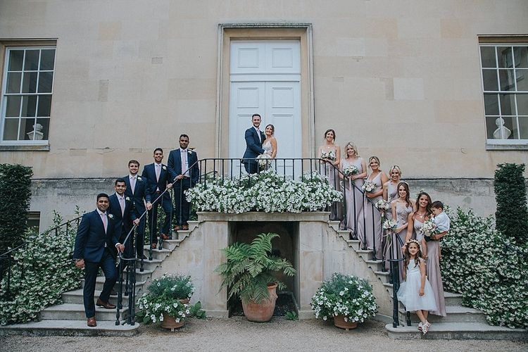Bridesmaid in Ghost Dress and Groomsmen in Navy Suits