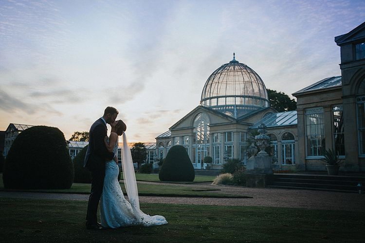 Sunset Portrait of Bride and Groom In Front of Syon Park Orangery