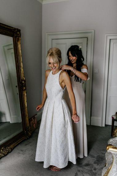 Bride Puts on Wedding Dress