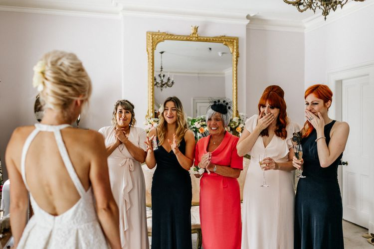 Bride Showing Bridesmaids and Family Members Backless Dress