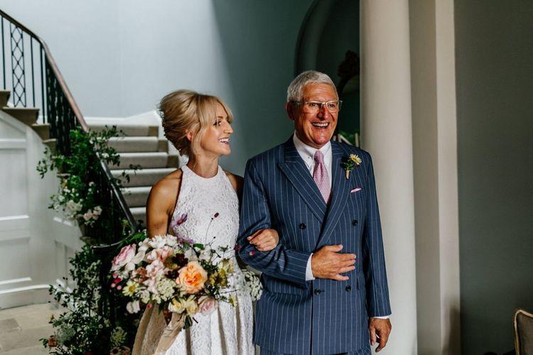 Bride and Father Prepare to Walk Down The Aisle
