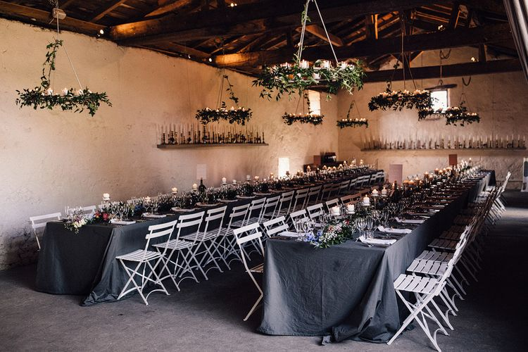 Wedding Reception Styled with Candles, Grey Tablecloths and Foliage Runners