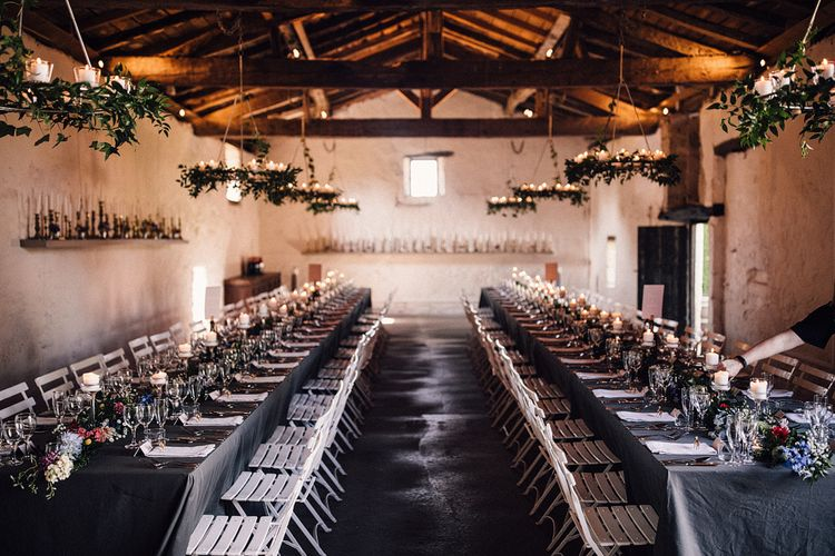 Banquet Tables with Grey Table Cloths and Floral Runners