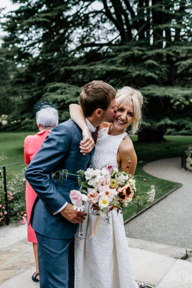Bride and Groom Embrace After Ceremony