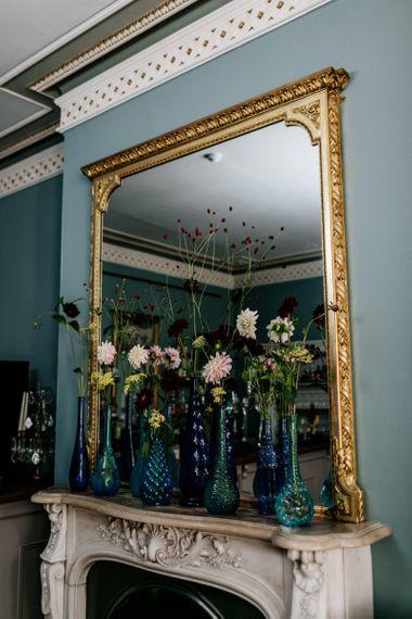 Mirror with Flower stems in vintage jars