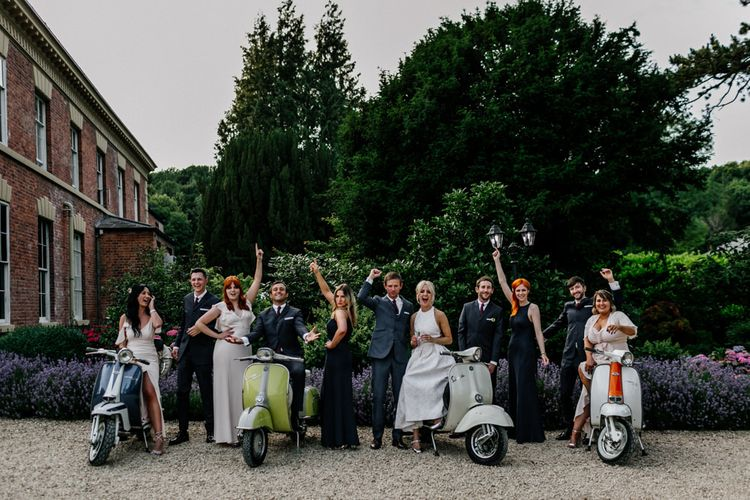 Bridal Party and Groomsmen In Front Of Vintage Vespers