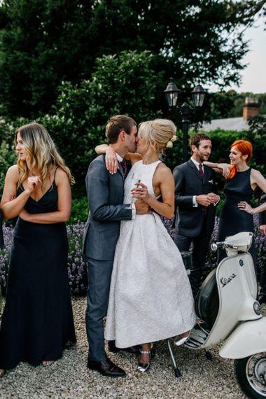 Bride and Groom Kiss In Front Of Vesper