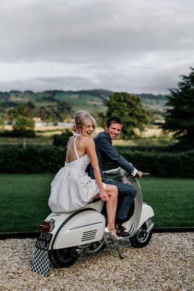 Bride Wearing Low Back Halterneck Dress on Vesper with New Husband