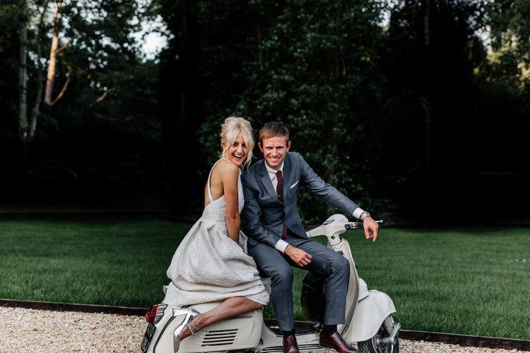 Bride and Groom Pose on Wedding Transport Choice Vintage Vesper