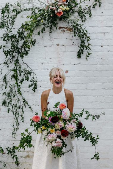 Bride Laughing Holding Beautiful Bright Bridal Bouquet