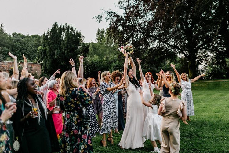 Guests Gather for Bride Bouquet Toss