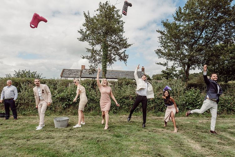 Garden Games For Outdoor Wedding // Stylish Minimal Wedding At River Cottage With Grooms In Reiss & Hugo Boss Images By Jason Mark Harris And Film From Harris Films